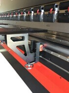 Sheet support mountain on linear guide for press brake